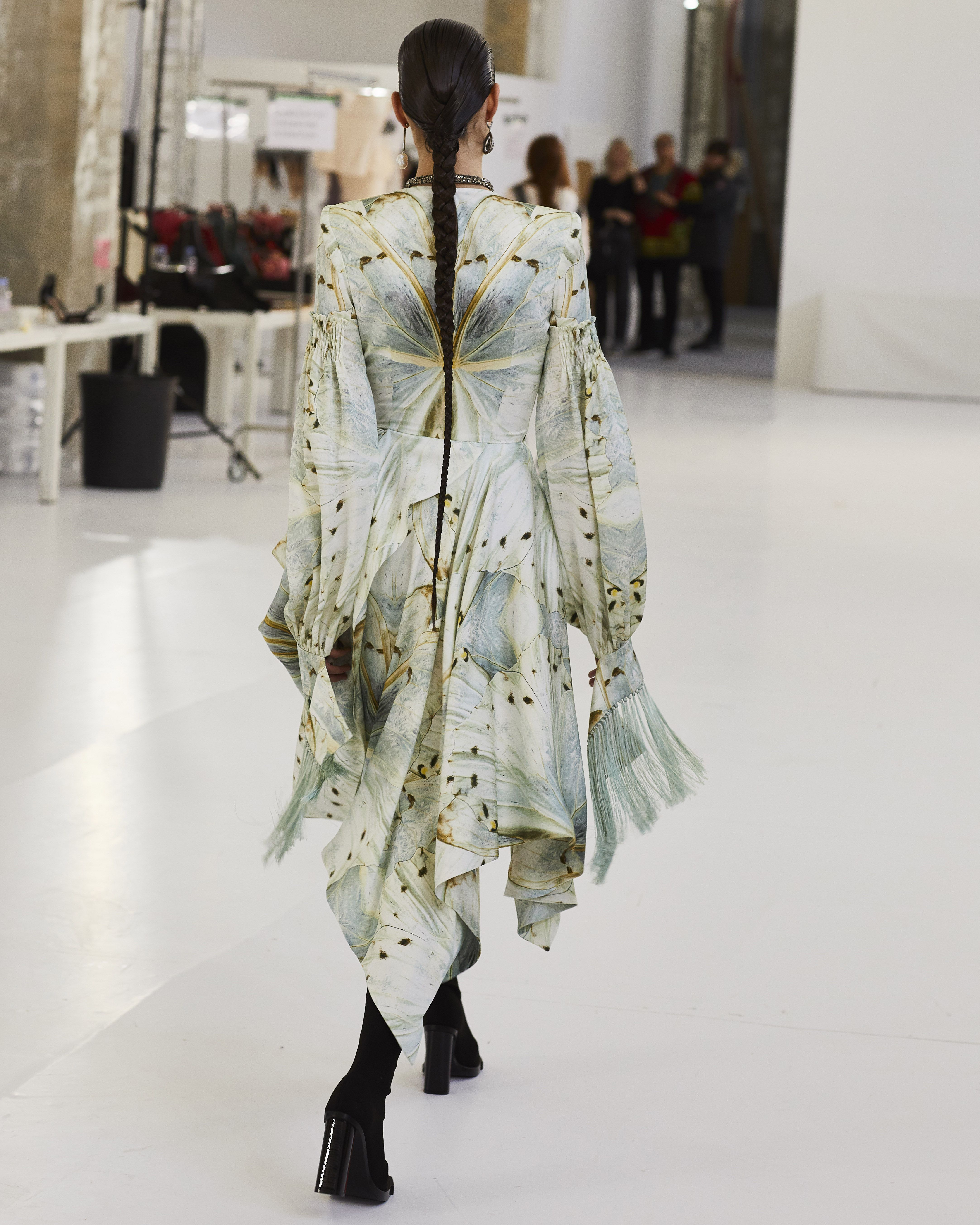 6378610d163 A silk dress is dappled with delicate glass wing butterfly prints.  Photographed by Sir Don McCullin in the atelier in the run up to the  Alexander McQueen ...