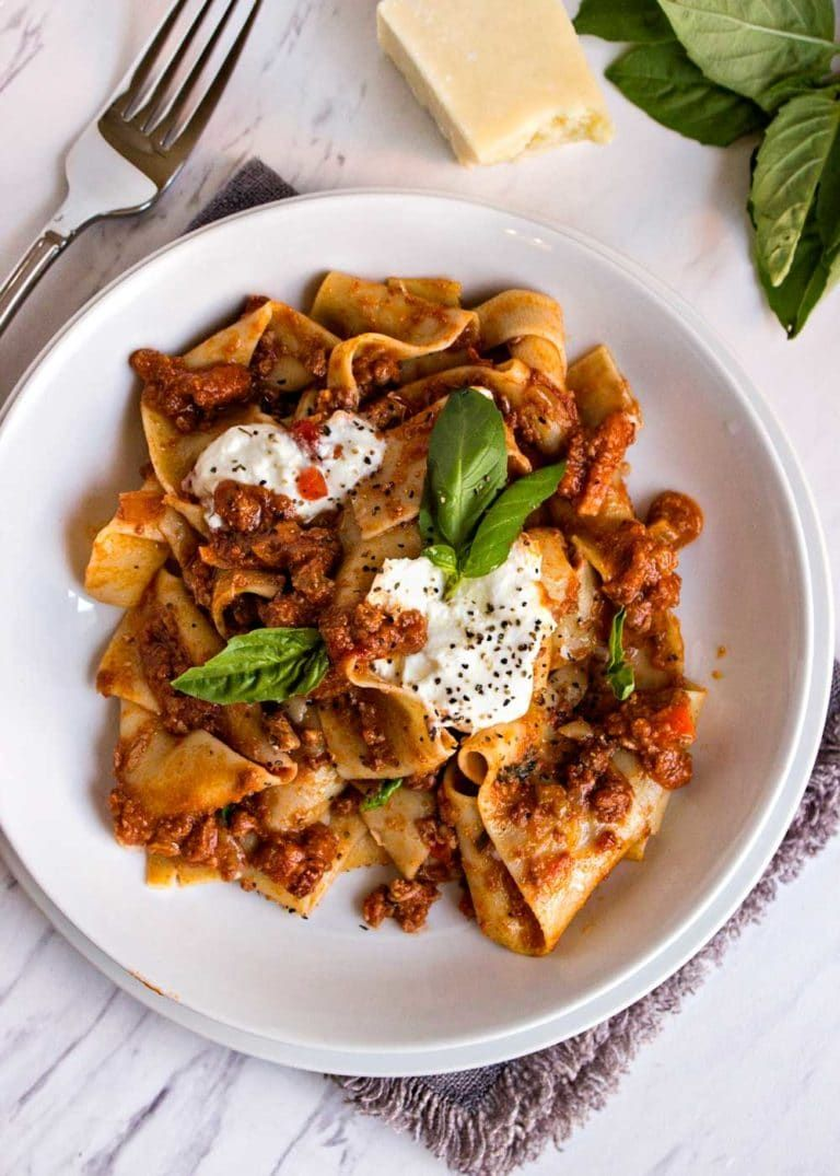 This Slow Cooker Bolognese Sauce is made in the slow cooker so you don't need to be standing over the stove all day. Authentic recipe using a great blend of spices and is super meaty and saucy. www.keviniscooking.com