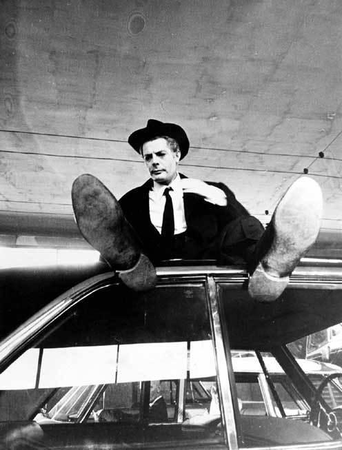 """Marcello Mastroianni on the set of Federico Fellini\'s """"8½\"""
