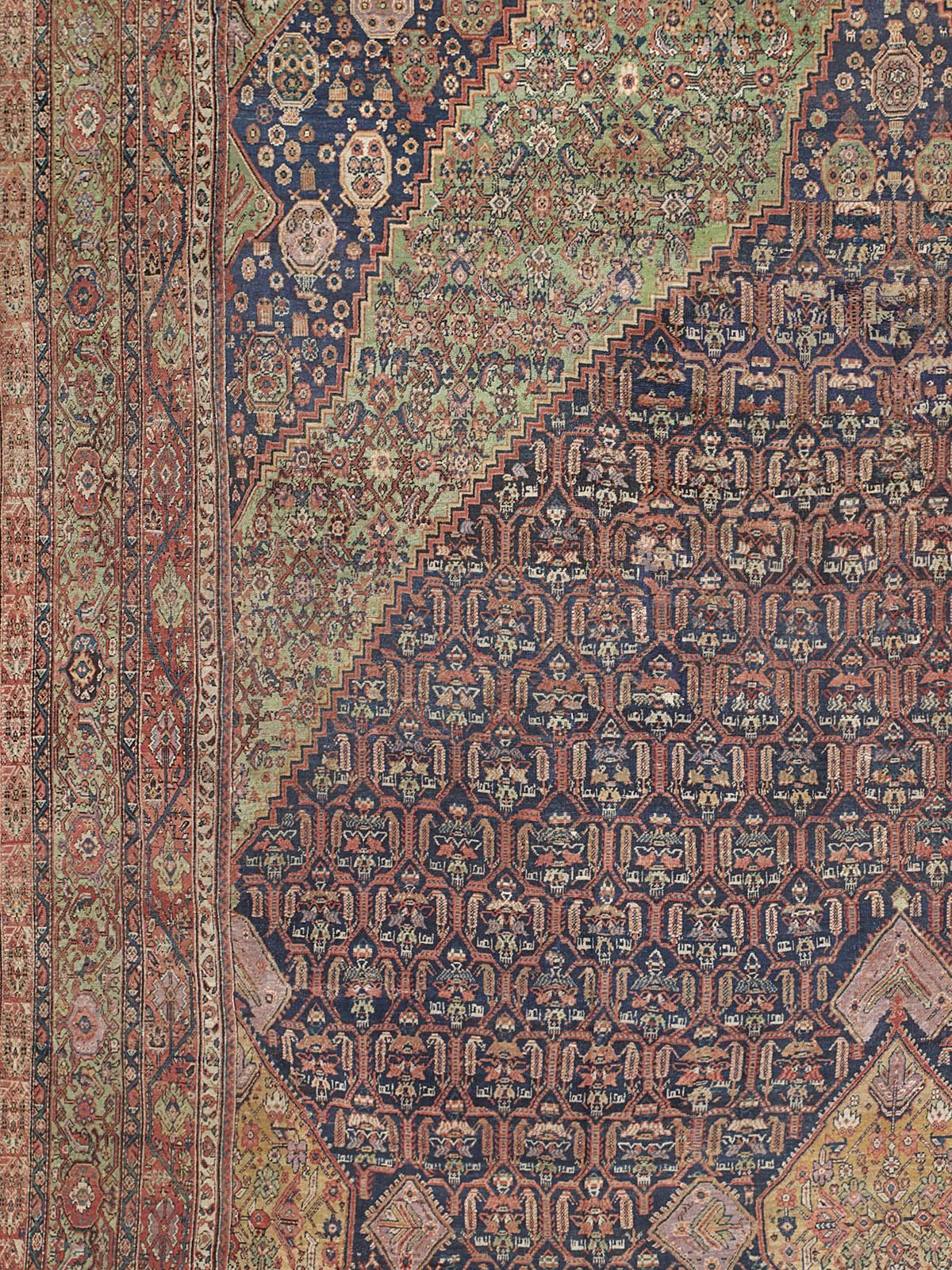 FERAHAN, West Central Persian, 16ft 9in x 26ft 7in, 2nd Quarter, 19th Century. Dazzling expanses of naturally dyed leaf green, burnished gold, and soft violet capture the connoisseur's attention in this tremendously impressive, extremely early Persian Ferahan. Palace size dimensions provide room for the fullest expression of its sought after 150-year-old artistry, as a singular arrangement of nested diamond medallions reveal nuanced variation of line and deep affinity for color.