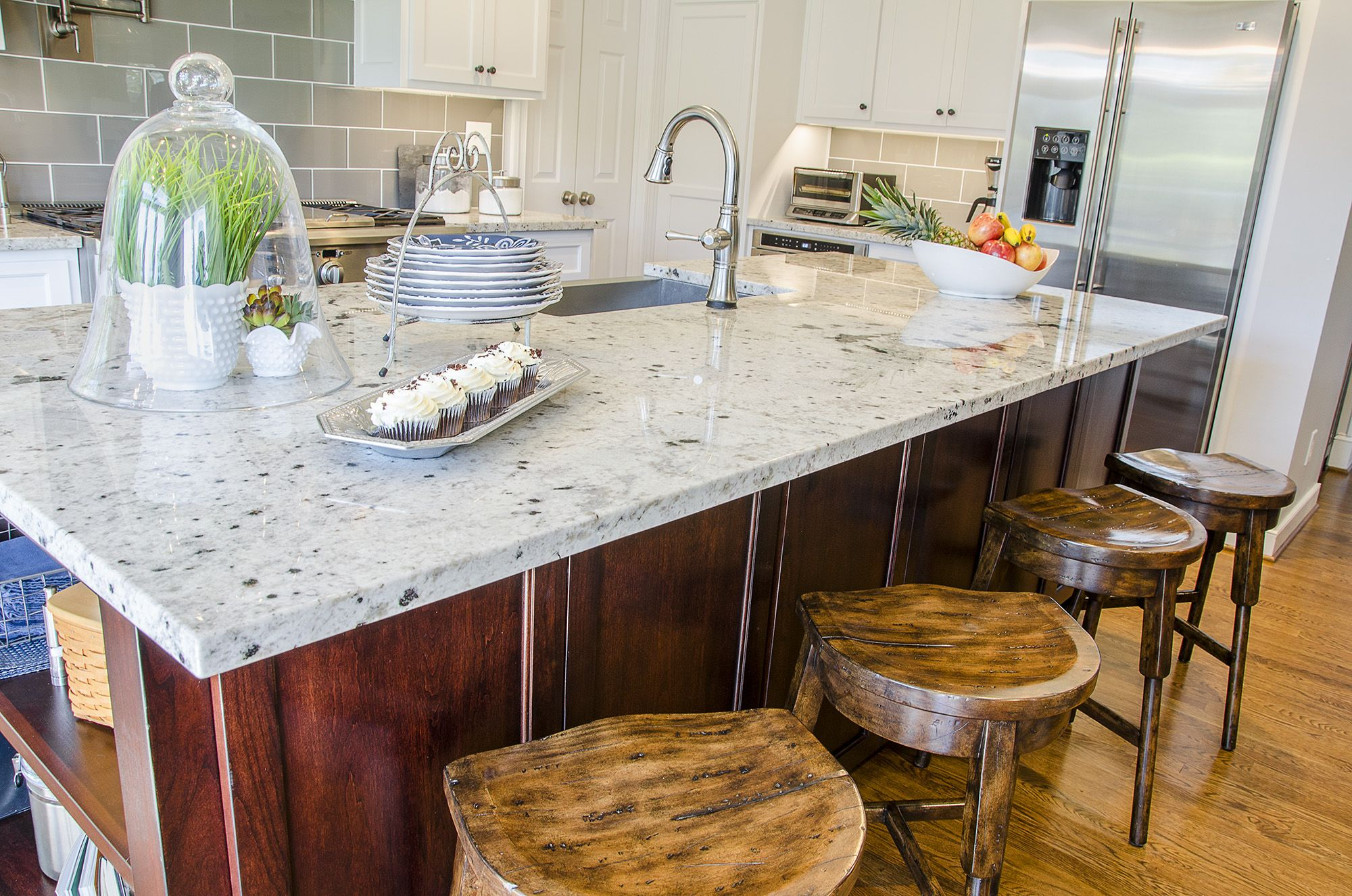 cherry wood kitchen island with granite countertops farmhouse sink and wood barstools on farmhouse kitchen granite countertops id=19646
