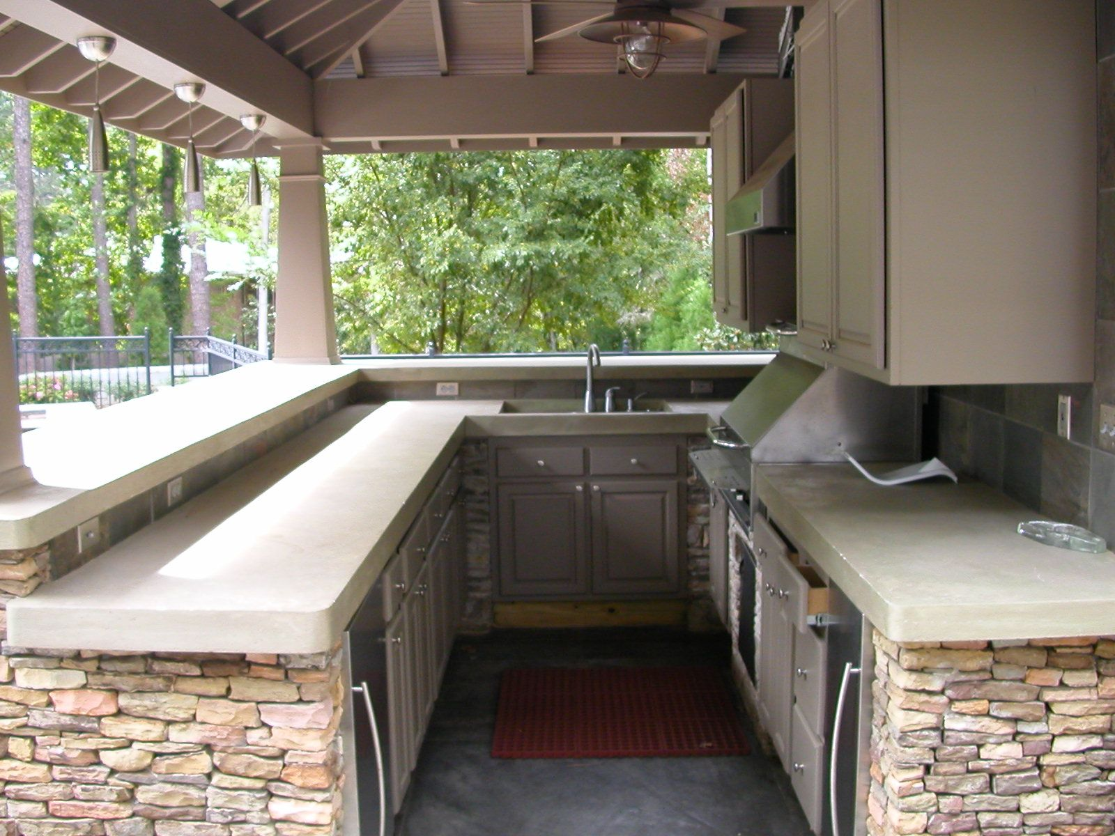 Outdoor kitchen designs with roofs shaped outdoor kitchen area