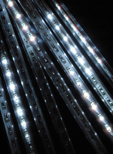 Meteor Icicle Lights White LED Plug In Eight 12 in. Tubes Clear Cord $34 I will have these!