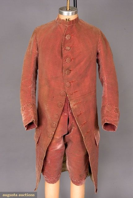 "Gentleman's Velvet frock coat and Breeches, 1760, England. Horizontally striped maroon silk velvet with cut, uncut and voided areas, narrow standing band collar, fitted sleeves with 4"" cuff, deep, shaped pocket flaps, front cut with curve over chest, twenty five self fabric covered buttons on jacket and fifteen on breeches, breeches with homespun facings. Augusta Auctions"