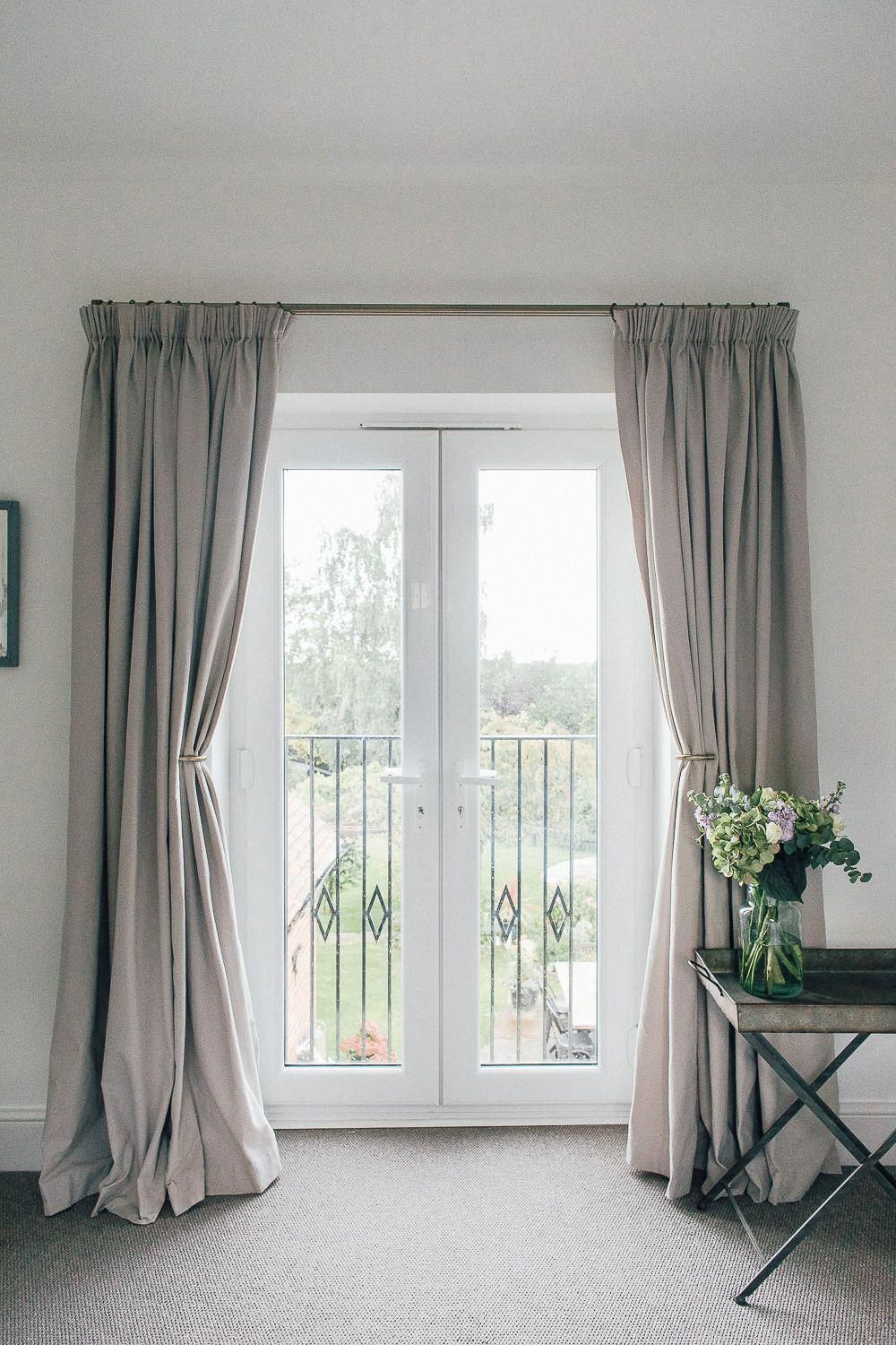 Full Length Grey Curtains On French Doors With Balcony Overlooking