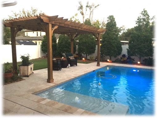 A 12x20 Cedar Big Kahuna Pergola Kit On The Pool Deck In