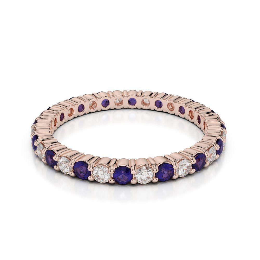 Diamond and tanzanite eternity ring diamond eternity ring