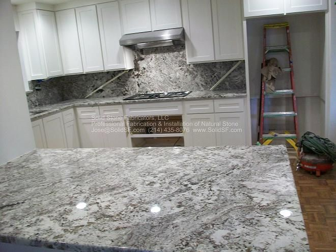 Ice Brown/ Alaska White Granite With White Cabinets. Visit  Globalgranite.com For Your