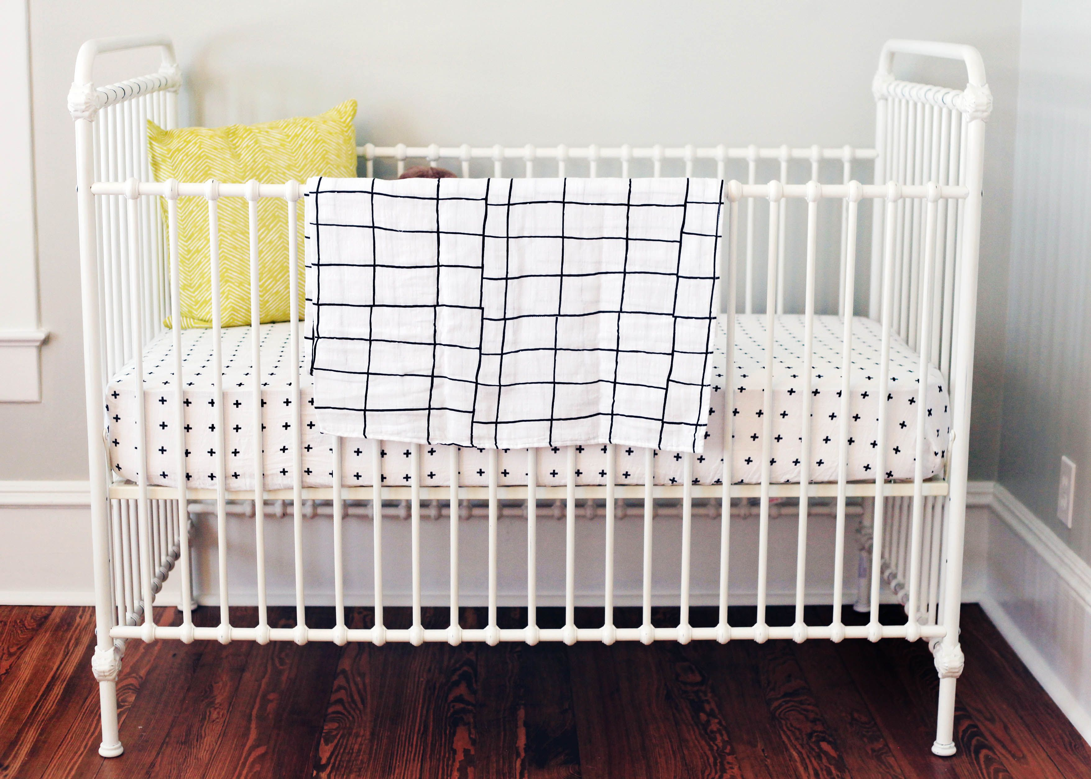organic crib sheet  swiss cross  crosses products and babies - a chic modern crib outfitted with modern burlap's organic muslin crib sheetand grid swaddle blanket