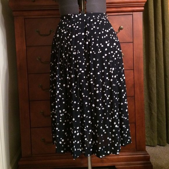 Vintage Sheer Navy Polka Dot Skirt Vintage size 14 fits like a modern-day size 8. Waist measures 14 1/2 inches. Has small belt loops but does not come with a belt. Length measures 27 inches. No tag to indicate material. Feels like polyester. Could also be worn as a dress or swim suit cover (pic 3). Vintage Skirts A-Line or Full