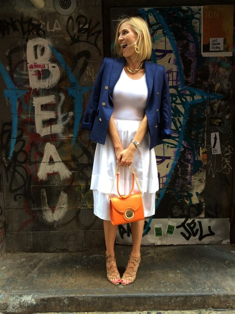 Kristen Taekman of RHONY wearing the orange Sobrina Bag!  Perfect color for Fall. Blush monogram tag.