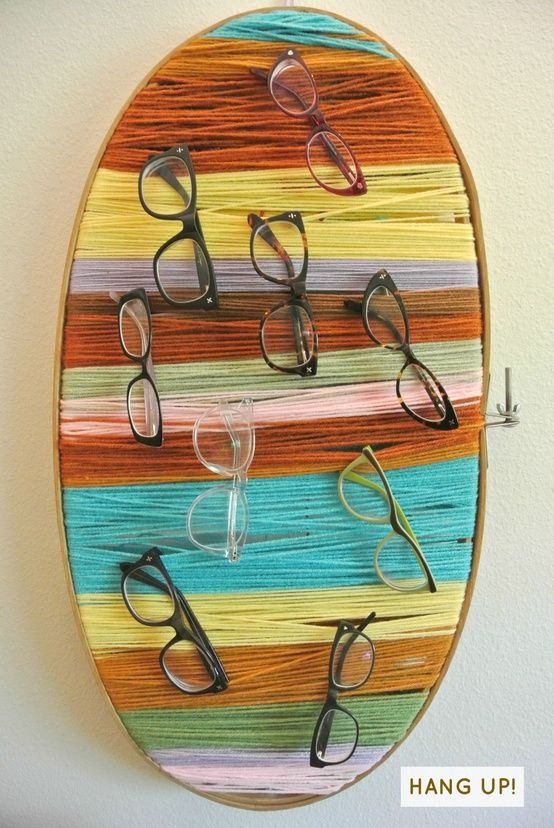 A Knitty-Gritty Glasses Display- Another idea that could be fun to make up. Using a backing such a cardboard, thread yarn, ropes (nautical theme) and hang eyewear. Millions of knitters have yarn (always re-usable), cardboard (free).. I could see a small series of these throughout the year.