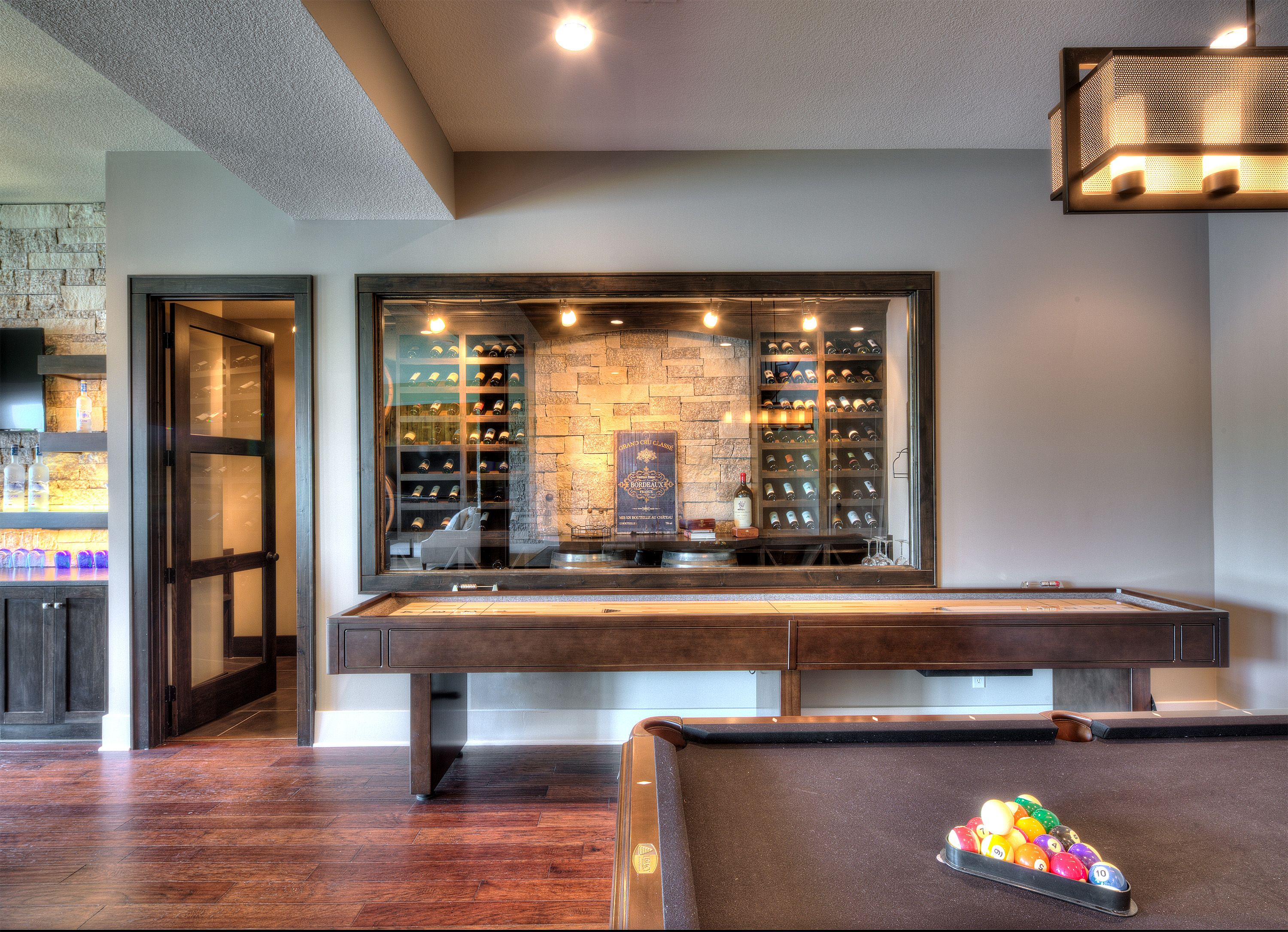 Basement With Pool Table, Wine Cellar And Shuffleboard Table