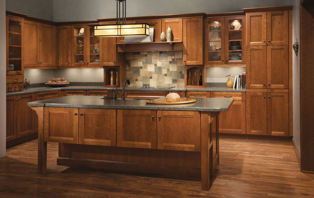 One Of Many Design Ideas For Your Kitchen From Kraftmaid Cabinets Available At Zeeland Kitchen Cabinet Design Kitchen Island Cabinets Rustic Kitchen Cabinets