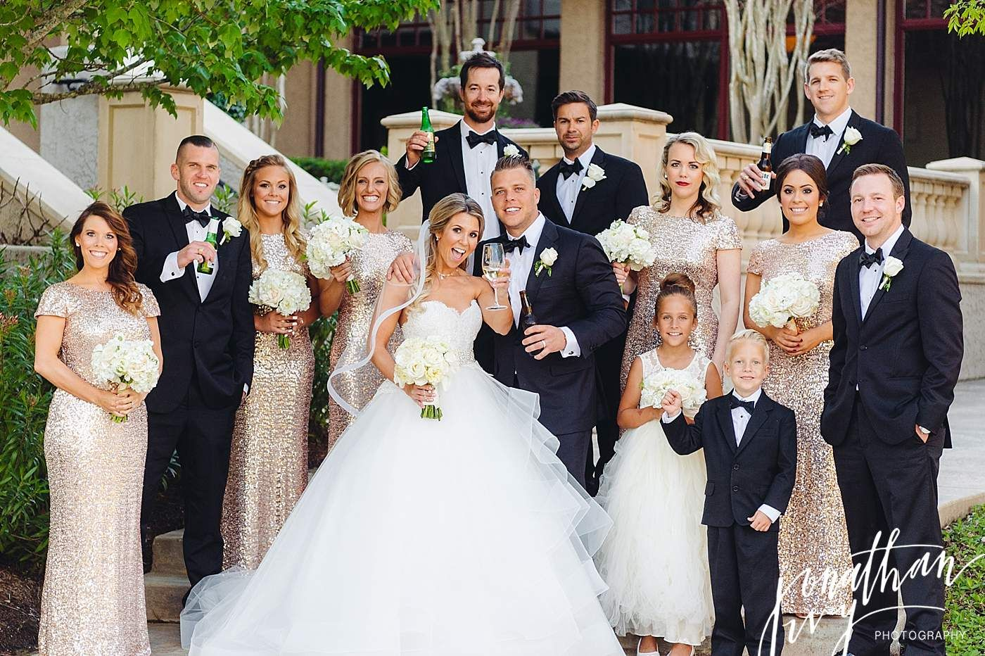 Ultra Glam Wedding Party With Gold Sequin Bridesmaid Dresses And Groomsmen In Tuxedos