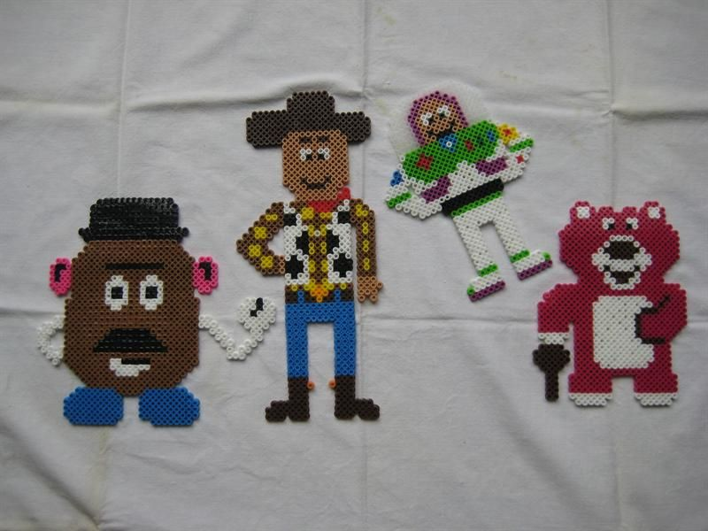 Toy Story characters (Mr. Potato Head, Woody, Buzz Lightyear, and Lotso the Hugging Bear)