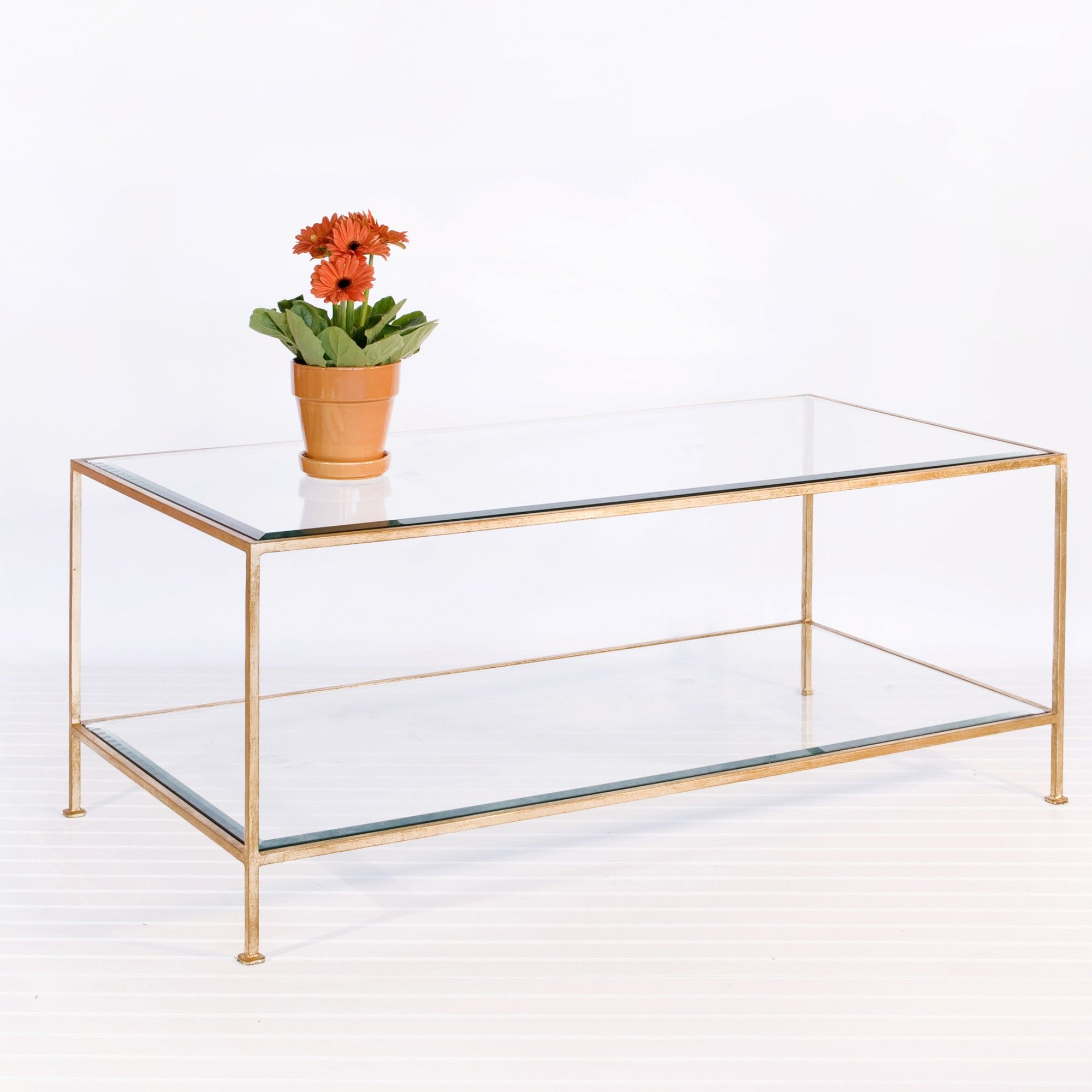 Hammered gold leaf with beveled glass shelves
