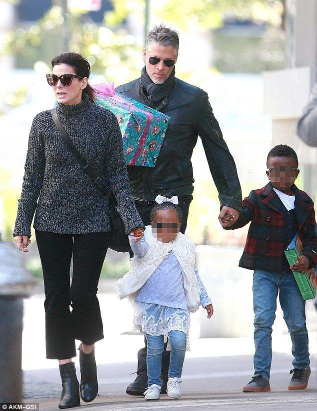 Sandra Bullock and Bryan Randall take her kids to a party ... Sandra Bullock's Son
