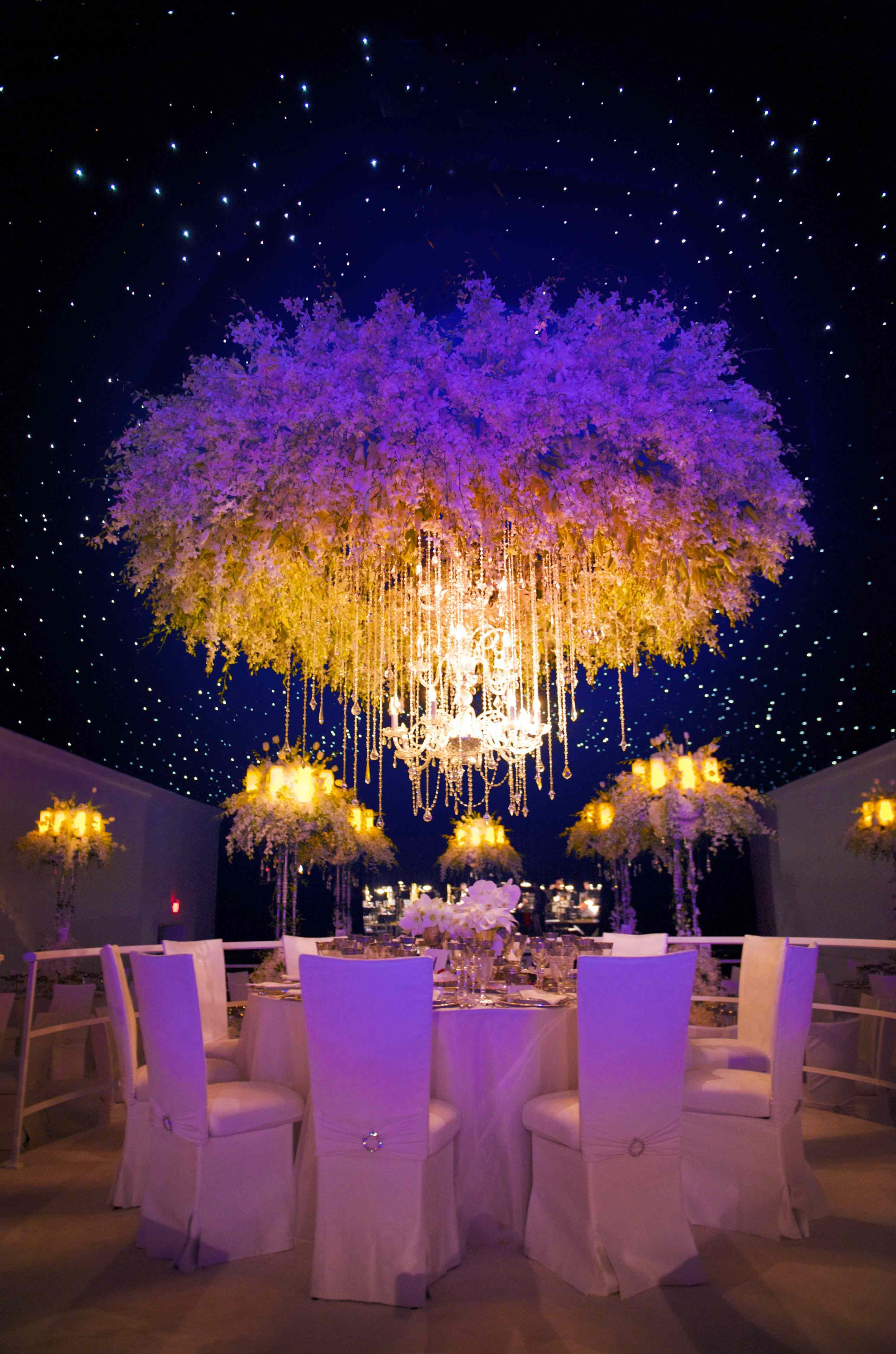 Chandelier suspended for the led panel ceiling in a tent between an chandelier suspended for the led panel ceiling in a tent between an amazing halo of floral mozeypictures Images