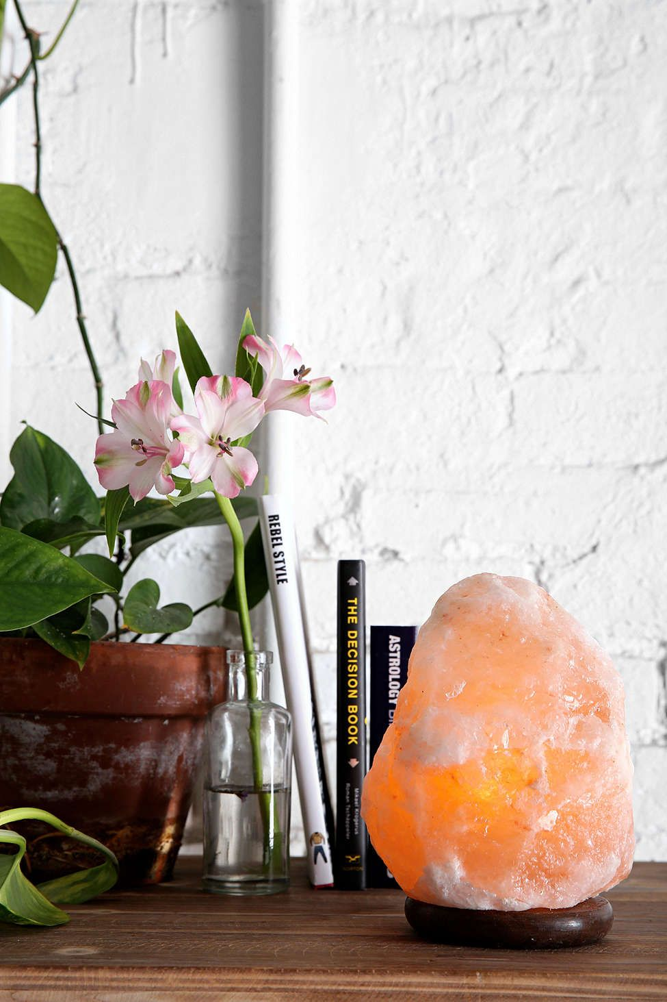 Himalayan salt lamp. It helps purify the air and helps people with allergies and asthma. I have one in the bedroom.