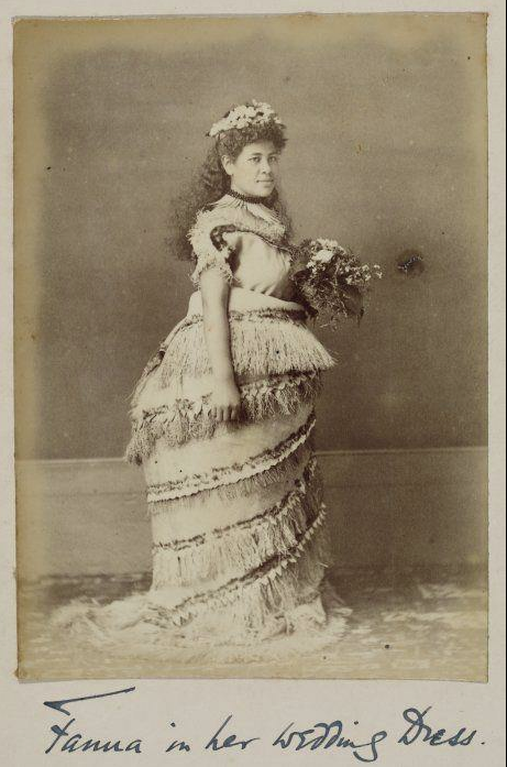 A photograph from the 1890s of a Samoan woman named Fanua in her wedding gown. Most is her use of local materials, but how much her dress looks like a bustle gown.