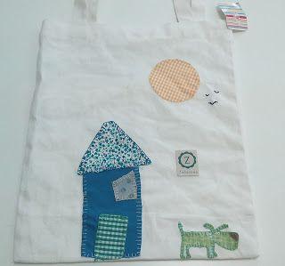 Bolso de tela decorado con dibujos infantiles mediante la técnica de patchwork