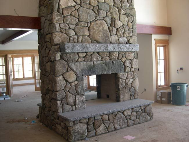 giant fieldstone fireplace | pass through fireplace | Pass-through fieldstone fireplace ...