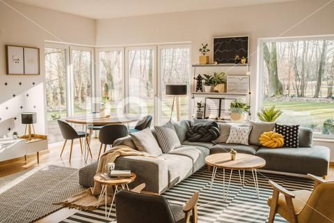 Wooden Round Dining Table In The Corner Of An Open Space Living Room Interio Stock Photos Feng Shui Living Room Open Space Living Room Apartment Living Room