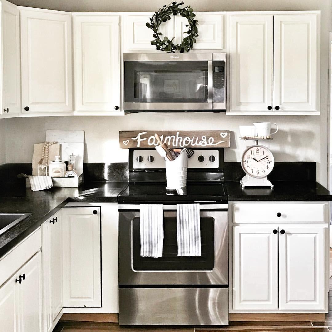 Farmhouse kitchen white and black granite. Modern