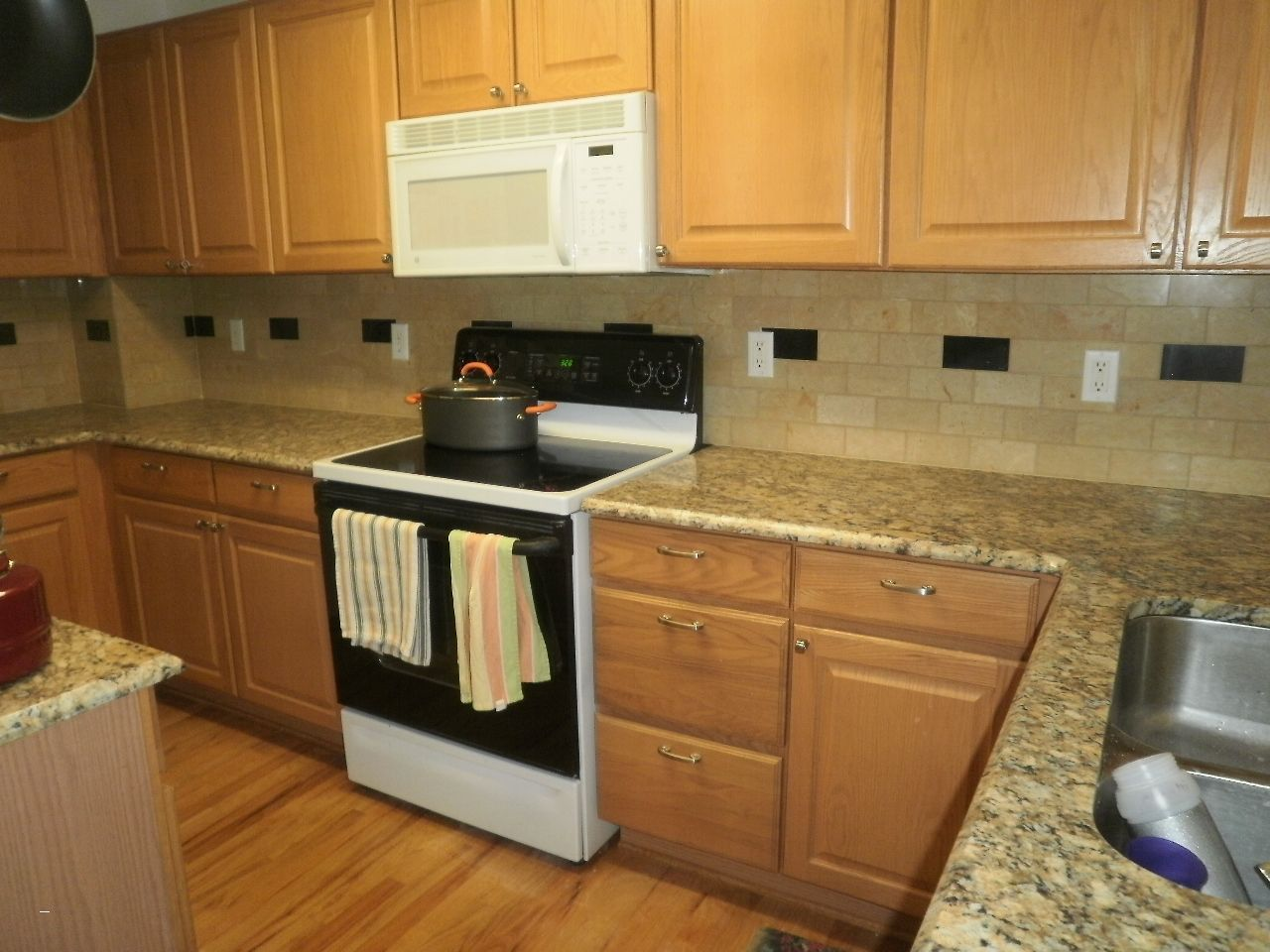 Kitchen Backsplash With Oak Cabinets Amazing Golden Oak Cabinets With White Appliances Giallo Ornamental Granite Backsplash Marble Backsplash