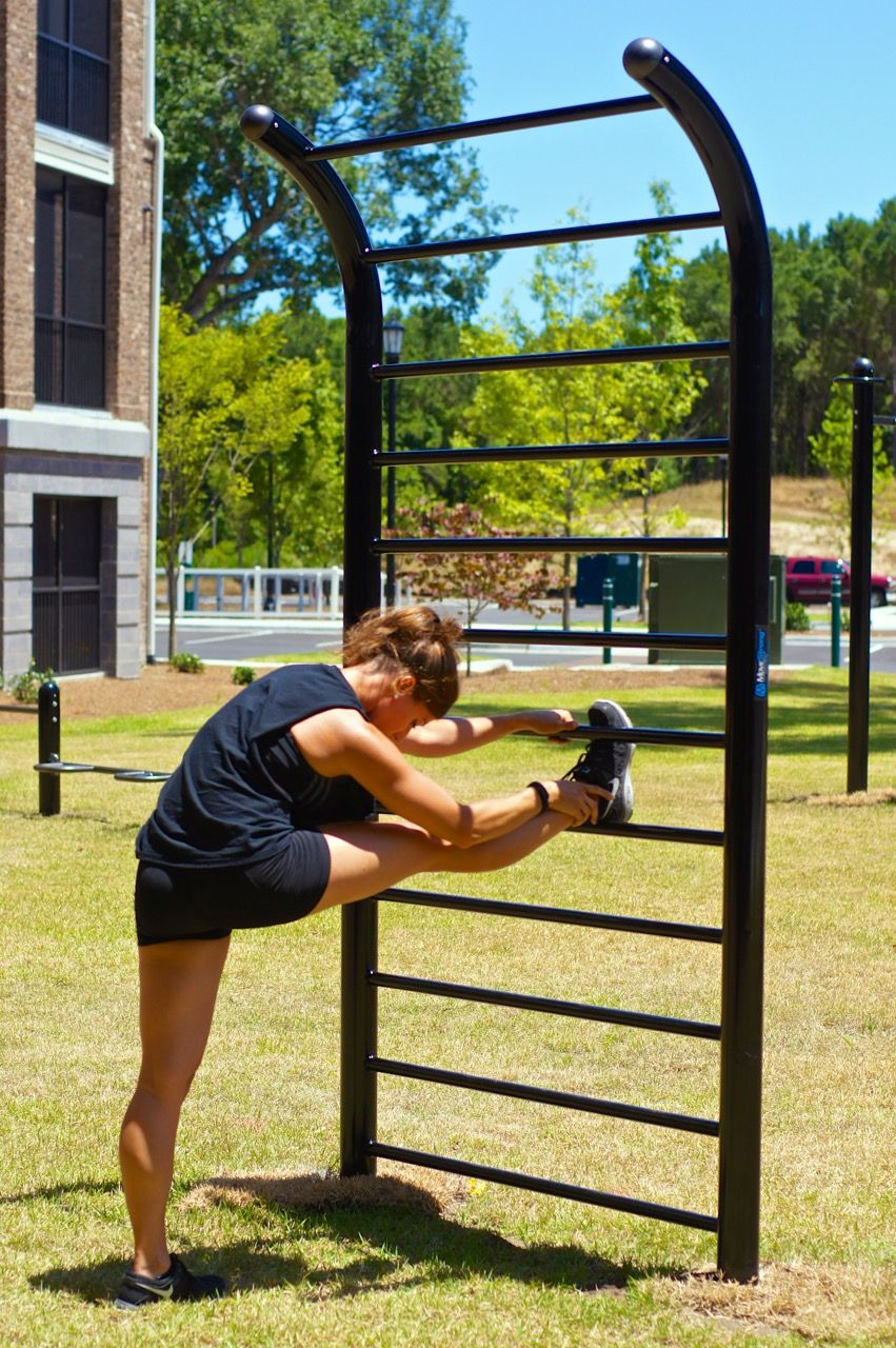 Outdoor Fitness Exercises And Stretching On The Movestrong Stall Bars Outdoor Fitness Equipment Outdoor Workouts No Equipment Workout