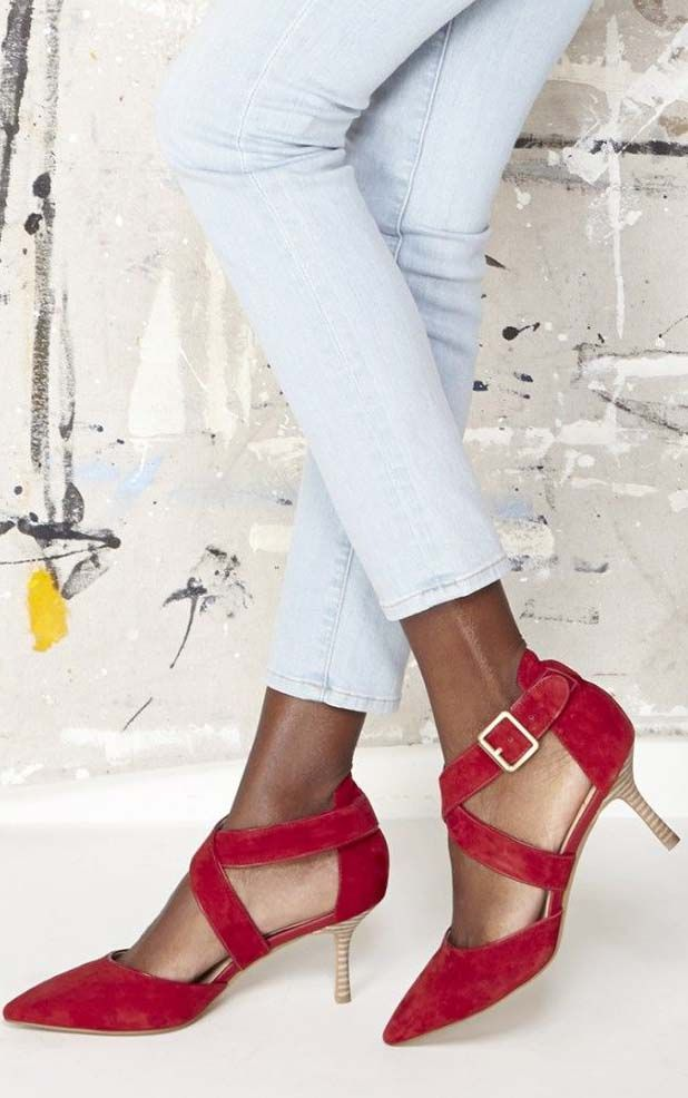 Classic red mid heels in soft suede with sweeping crossed strips and pointed toes