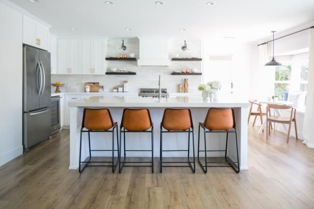 Designer Lindye Galloway transformed a dated 1950s home into a fresh, modern farmhouse. See it on HGTV.com.