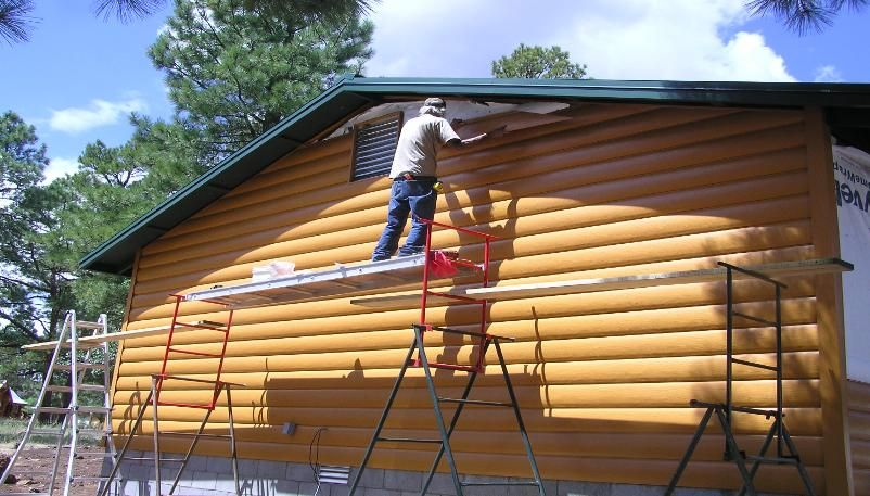 Log look vinyl siding log cabin steel siding vinyl for Log vinyl siding pictures