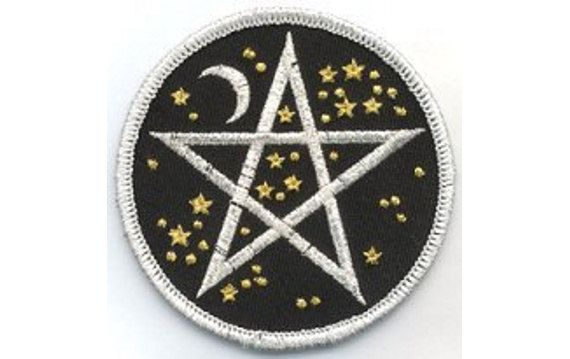 Sew this beautifully embroidered cloth patch to your favorite clothing, accessories, or ritual wear. It consists of a silver interwoven pentagram