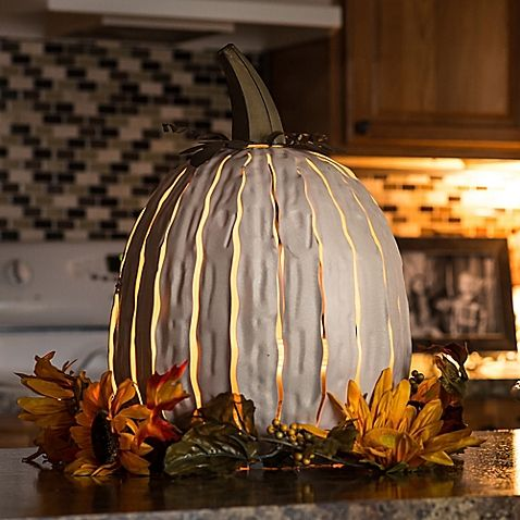 Light up your porch on an autumn evening with this artisan-crafted - indoor halloween decoration ideas