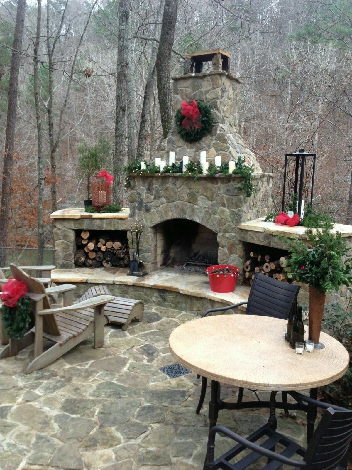 Outdoor fireplace decorated for the holidays christmas in