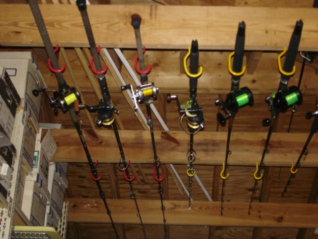 Ideas for a wall mounted fishing rod reel holder the for Homemade fishing rod storage ideas