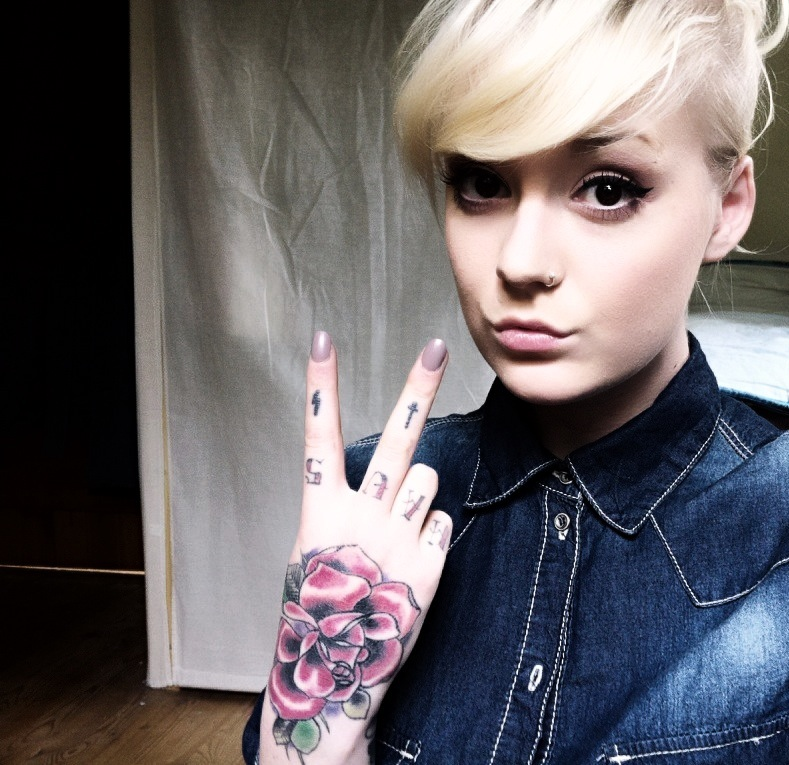 Cool girl with hand tattoo.