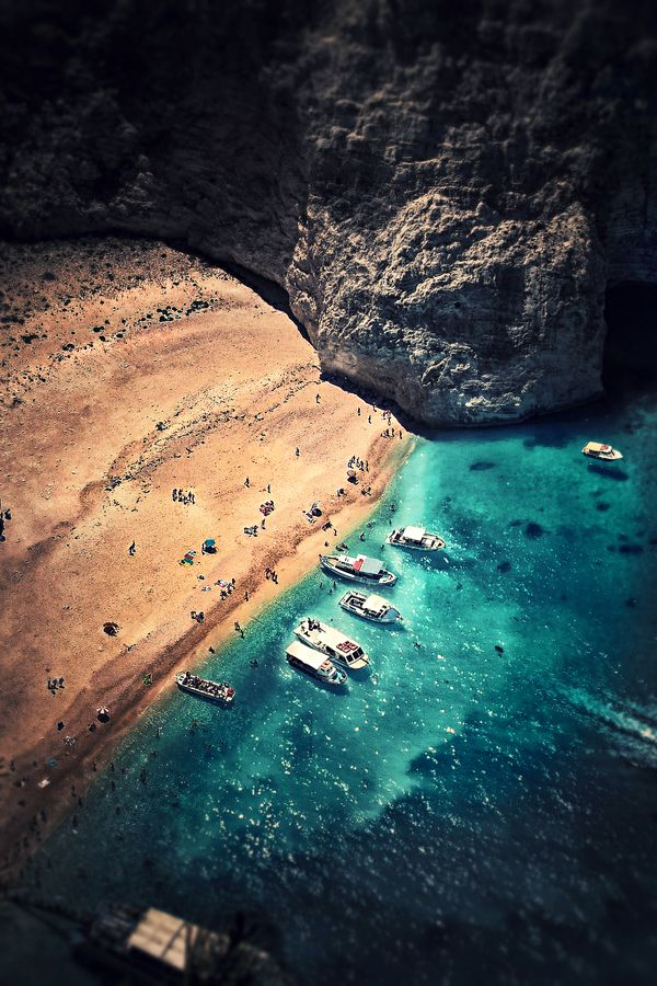 Secret beach with blue waters and boats