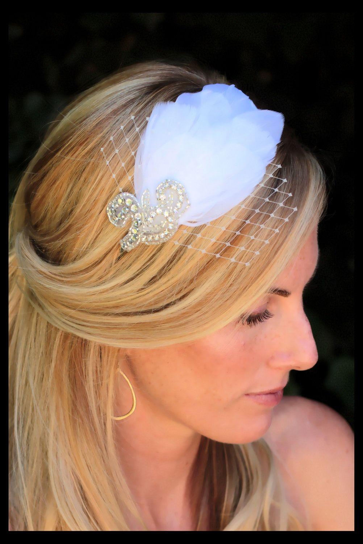 Ann - Vintage inspired  rhinestone and feather bridal headband. $42.00, via Etsy.
