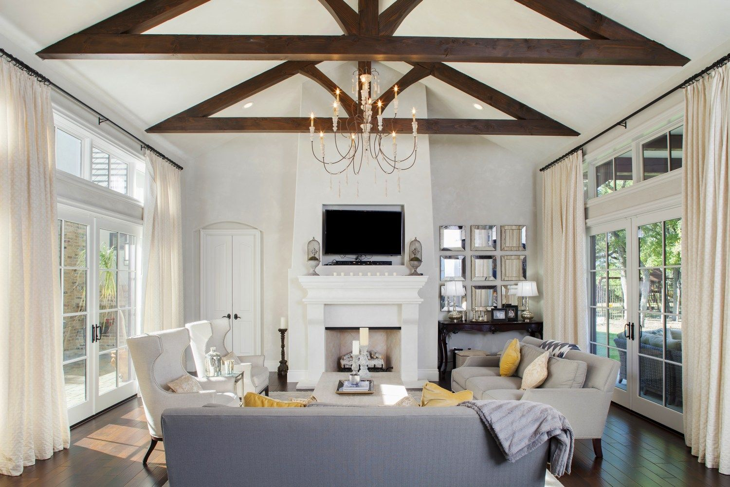 Cathedral ceiling, wood beams, ebony stained floors, walls of ...