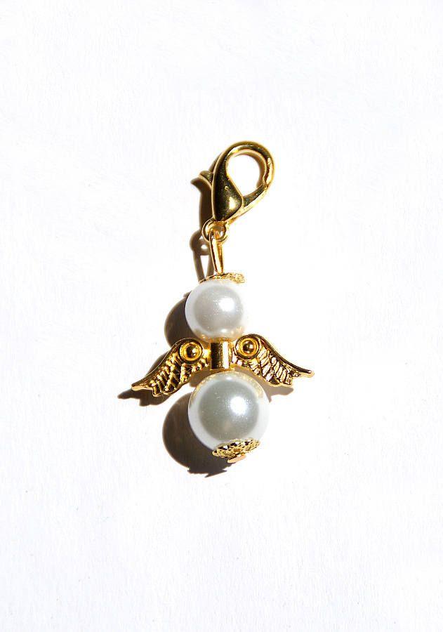 Kette mit flugel und perle