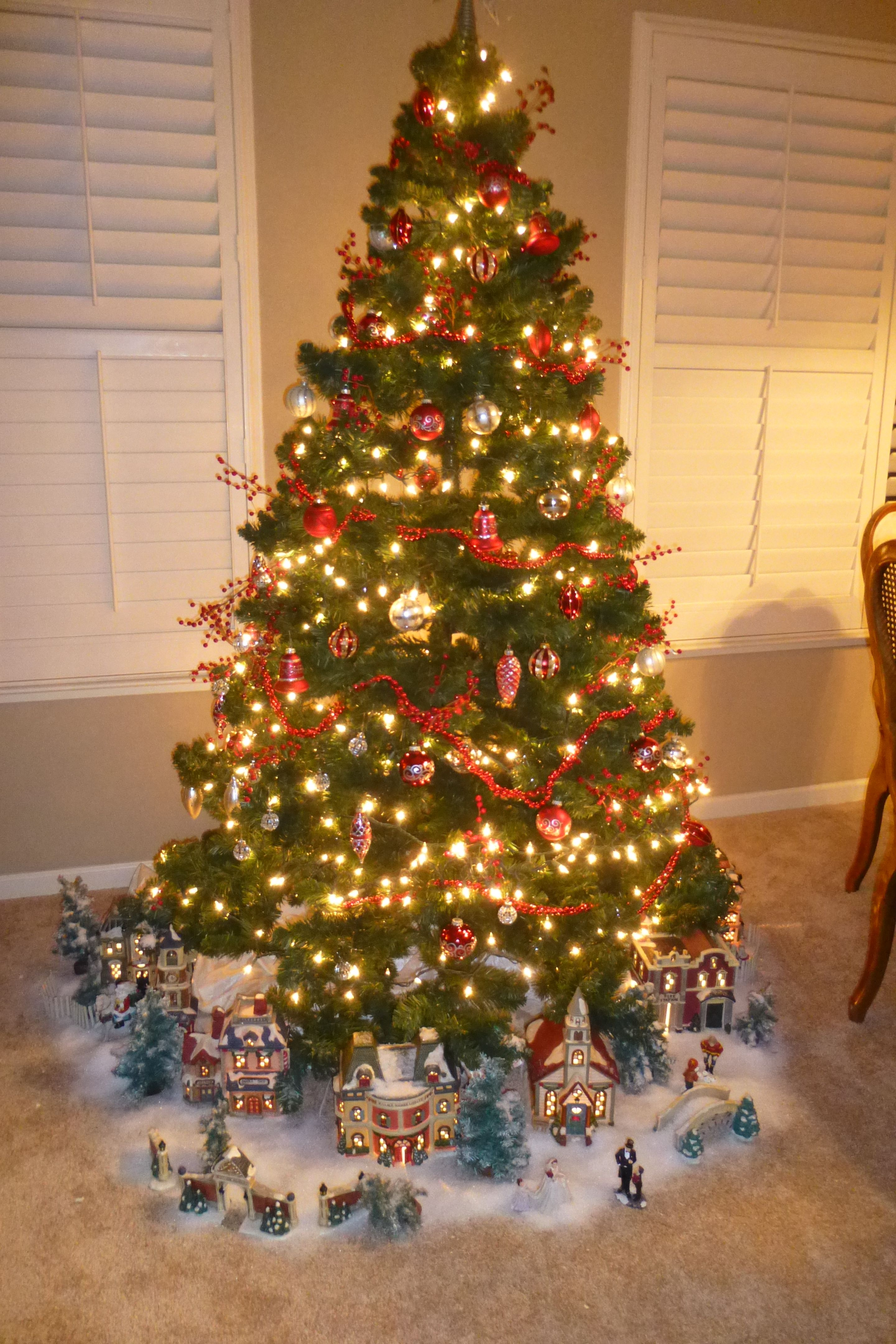Display Your Christmas Village Under The Tree Because Santa Doesn T Bring Presents Til Christmas Tree Themes Christmas Tree Village Christmas Village Display
