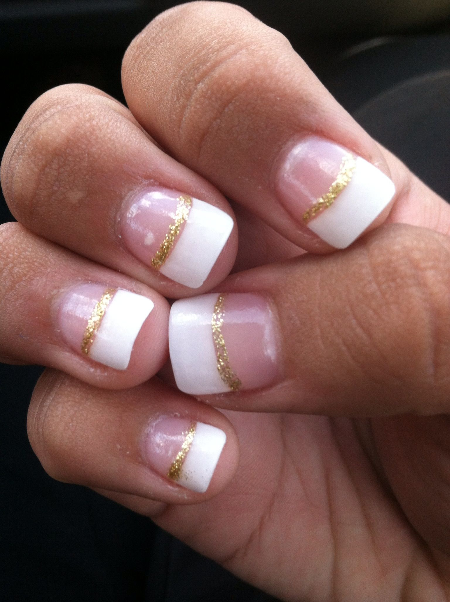 white french tip with gold glitter manicure nails