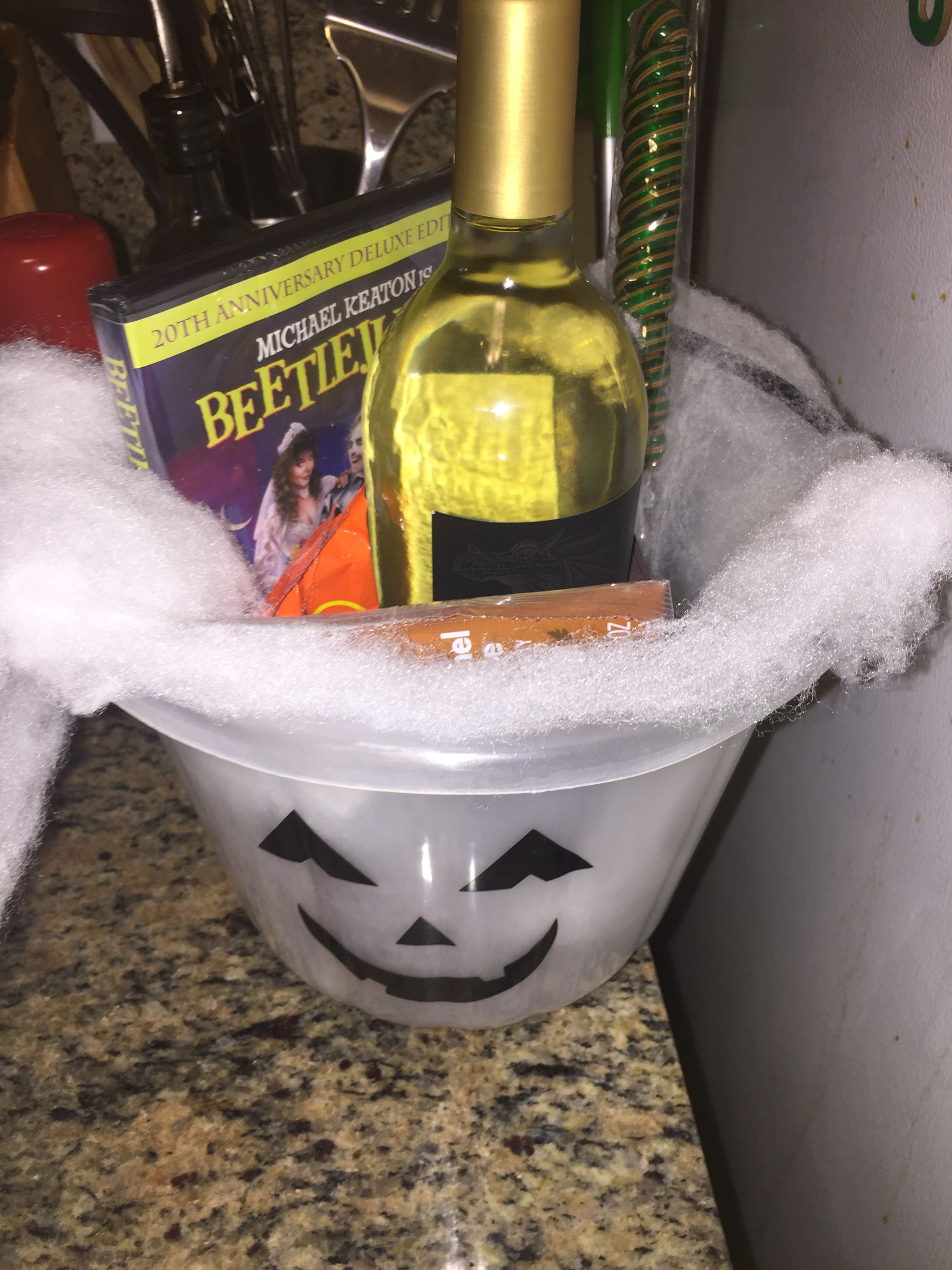 Halloween Costume contest prize ideas diy gift idea costume contest gift Halloween goodie bucket for adults I put wine , candy apple twizzlers, chocolates, mint gum, a lighter, a Halloween movie, candy apple lollipops and wala there u have it! #spookybasketideas