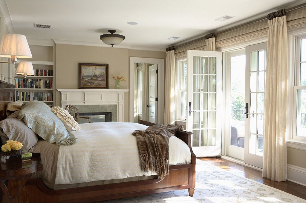 Master bedroom with fireplace, bookshelf and French doors ...