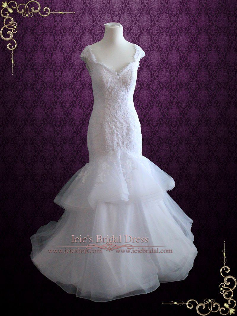 Lace mermaid wedding dress with open back cap sleeves and ruffle