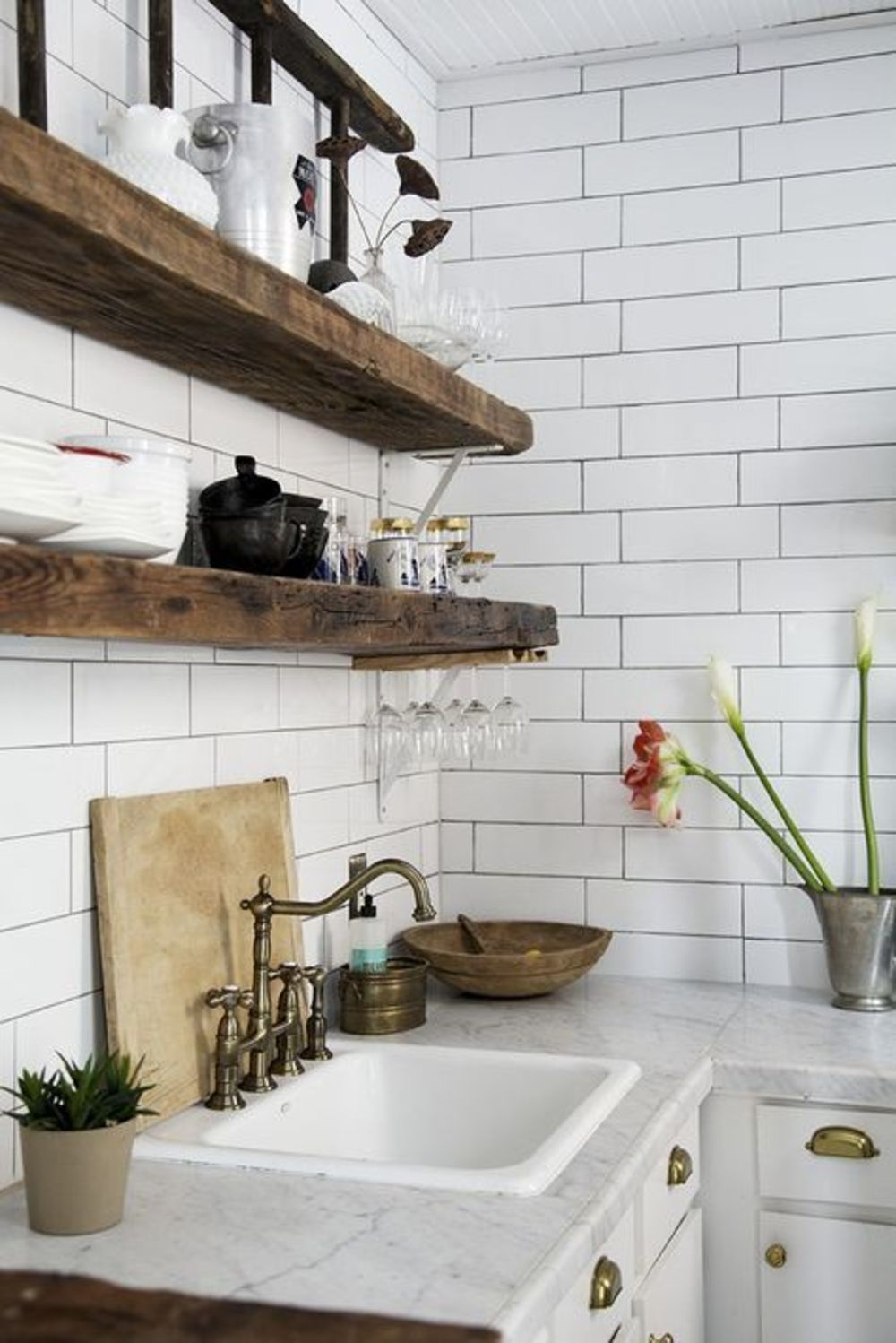 Rustic shelves white subway tile greywhite marble counters kitchen with white subway tile walls white marble countertop brass fixtures reclaimed wood open shelving dailygadgetfo Images