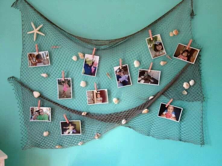 Part Of The Decor In Kenadee S Under Sea Room I Spray Painted A Fishing Net And Hot Glued Shells On It We Use To Hang Pictures Crafts